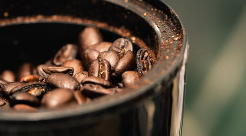 Image of some coffee beans in a grinder.