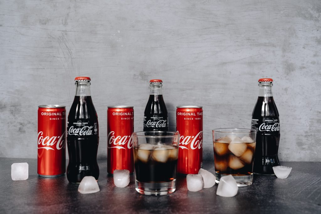 Image of cans and bottles of Coca Cola.