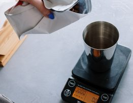 Image of coffee being weighed.